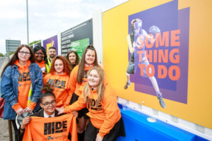 "Young people from Manchester have continued their collaboration with award-winning designers, Forever Agency, to create a series of eye-catching hoardings which are situated around the new Youth Zone site in Gorton. After revealing the new name and logo for HideOut Youth Zone earlier this year, their latest collaboration with Forever Agency includes the unveiling their specially designed hoardings around the Youth Zone site, located on Hyde Road. Inspiration for the hoardings came from the Youth Zone's offer to provide young people with somewhere to go, something to do, and someone to talk to, 7 days a week for just 50p per visit. ""The designs give people a taste of what's to come once the Youth Zone is open next year"" said one young person involved in the design process. Once officially open in Summer 2020, the state-of-the-art Youth Zone will provide thousands of young people from across Manchester with access to over 20 activities per night, from sports in the four-court sports hall, martial arts room and 3G kick pitch; to art, drama, music, cooking and enterprise and employability opportunities. Earlier this year the young people's development group unveiled their vision for the new OnSide Youth Zone located on Hyde Road. Working together with Forever Agency, their first task was to create a name, logo and brand identity for the new £6.6million Youth Zone. 'HideOut' Youth Zone was chosen by over 2,000 young people in a city-wide poll led by the young people's development group in partnership with local schools. Tom Booth, Head of Agency of Forever Agency said: ""We are incredibly proud to be working with OnSide on this exciting youth-led project, as a Manchester based agency it is important for us to be giving back to local charities. Working with young people on creating the brand for the new Youth Zone has been inspiring, not just for them but for us too."" Adam Farricker, HideOut Youth Zone Chief Executive, said: ""It has been a fantastic opportunity for young people from Manchester to work closely with an award-winning design agency. ""A huge thank you to Forever Agency for their help and support in bringing HideOut Youth Zone to life, putting young people at the heart of the branding and design process has been an incredible journey and I look forward to seeing what they come up with next. As a charity, we are very lucky to have such tremendous support from organisations like Forever Agency who can support us in bringing the Youth Zone to life for young people."""